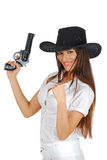 Hot cowgirl with the gun smiling Royalty Free Stock Photos
