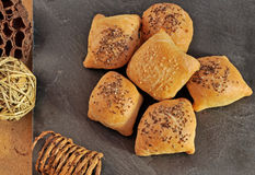 Hot and crispy homemade puff pocket pies with meat and sprinkled with sesame and chia seeds. stock photography