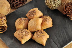 Hot and crispy homemade puff pocket pies with meat and sprinkled with sesame and chia seeds. royalty free stock photo