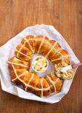 Hot cross bun ring with butter Royalty Free Stock Images