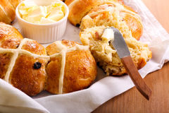 Hot cross bun ring with butter Royalty Free Stock Photo