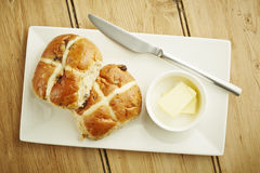 Hot cross bun on white dish Stock Photo