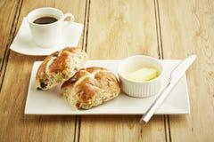 Hot cross bun on white dish Royalty Free Stock Images