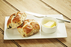 Hot cross bun on white dish Royalty Free Stock Images
