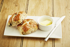 Hot cross bun on white dish Stock Images