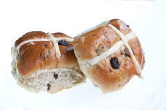 Hot Cross Buns. Two traditional hot cross buns isolated in the studio Royalty Free Stock Photos