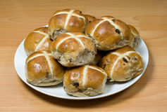 Hot cross buns 2. Hot cross buns with wood background Royalty Free Stock Images