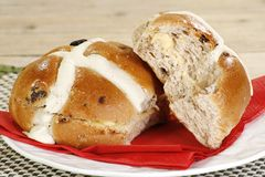 Hot cross buns. Two buttered hot cross buns on a white plate Royalty Free Stock Images