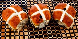 Hot cross buns. A closeup of three hot cross buns Royalty Free Stock Photography
