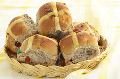 Hot cross buns. Fresh baked hot cross buns in wicker basket Royalty Free Stock Photo
