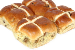 Hot Cross Buns. Fresh hot cross buns against a white background royalty free stock photography