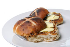Hot Cross Buns. Toasted and buttered hot crossed buns for Easter Royalty Free Stock Image