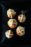 Hot cross buns on a baking sheet Stock Photos