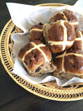 Hot cross buns in basket Stock Image