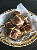 Hot cross buns in basket Stock Images