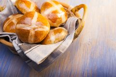 Hot cross buns on basket Top view, copy space. Easter baking.  royalty free stock image
