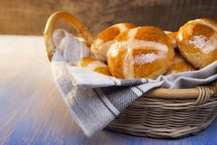 Hot cross buns on basket Top view, copy space. Easter baking.  stock photos