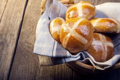 Hot cross buns on basket Top view, copy space. Easter baking royalty free stock photography