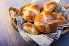 Hot cross buns on basket Top view, copy space. Easter baking.  royalty free stock photo