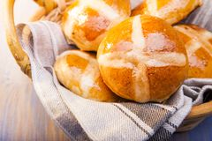 Hot cross buns on basket Top view, copy space. Easter baking royalty free stock images
