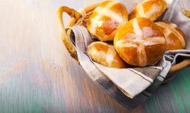 Hot cross buns on basket Top view, copy space. Easter baking