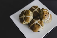 Hot cross buns on black table. Close-up shot with shallow depth of field Stock Photo