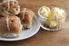 Hot cross buns with butter Stock Photos