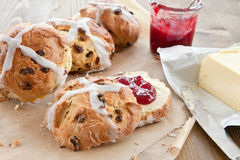 Hot cross buns with butter and jam Stock Photography