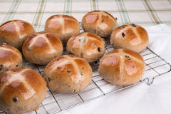 Hot cross buns  on a cooling rack  with a napkin Royalty Free Stock Images