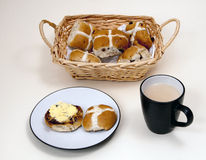Hot-cross buns and a cup of tea. Royalty Free Stock Photography