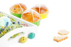Hot cross buns and easter decorations Stock Image