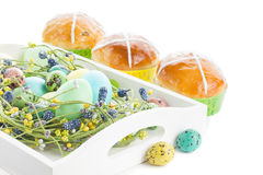 Hot cross buns and easter decorations Royalty Free Stock Images