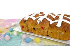 Hot Cross Buns with Easter egg candy Royalty Free Stock Image