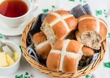 Hot Cross Buns. Fresh baked hot cross buns with butter Stock Photography