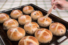 Hot cross buns glazed  baked and being glazed Royalty Free Stock Photography