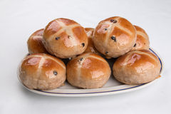 Hot cross buns heaped on an oval plate isolated on white Royalty Free Stock Photos