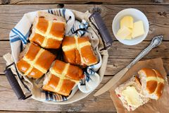 Hot Cross Buns, overhead scene on rustic wood Royalty Free Stock Image