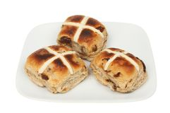 Hot cross buns on a plate. Toasted hot cross buns on a plate isolated against white Stock Image