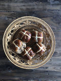 Hot cross buns in round basket Stock Photos