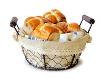 Hot Cross Buns in a vintage wire basket over white Stock Photos