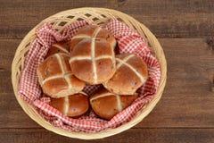 Hot cross buns in wicker basket Royalty Free Stock Image