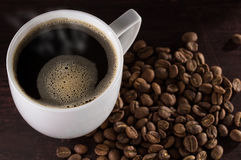 Hot cup of brewed black coffee on wooden table Stock Photography