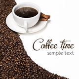 Hot cup of coffe. Bean and aromatic cinnamon royalty free stock photo