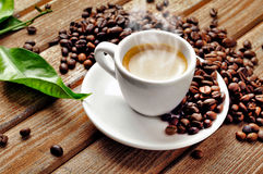Hot Cup of coffee. A hot cup of coffee with coffee-beans royalty free stock image