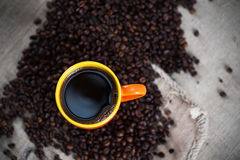 Hot cup of coffee. Cup of hot coffee on coffee beans with coffee bag, close-up stock images