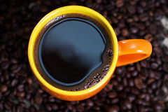 Hot cup of coffee. Cup of hot coffee on coffee beans, close-up Stock Photography
