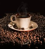 Hot cup of coffee and beans Royalty Free Stock Image