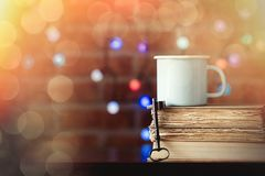 Hot cup of coffee and books with key Royalty Free Stock Photo