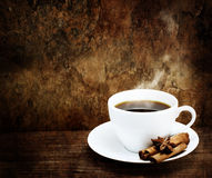 Hot Cup of Coffee with Cinnamon and Star Anise Royalty Free Stock Photos