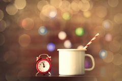 Hot cup of coffee and classic alarm clock Stock Image